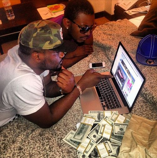 PHOTO: Jude Okoye Flaunts dollar bills